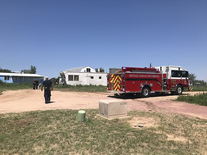 Members of CAFMA surround a trailer on the 1000 block of El Rancho Road in Chino Valley on Friday, Aug. 3, 2018,  as they investigate a fire. A body was found inside the mobile home. The male subject reportedly had a medical episode late Thursday, Aug. 2, before the fire began. (CAFMA/Courtesy)
