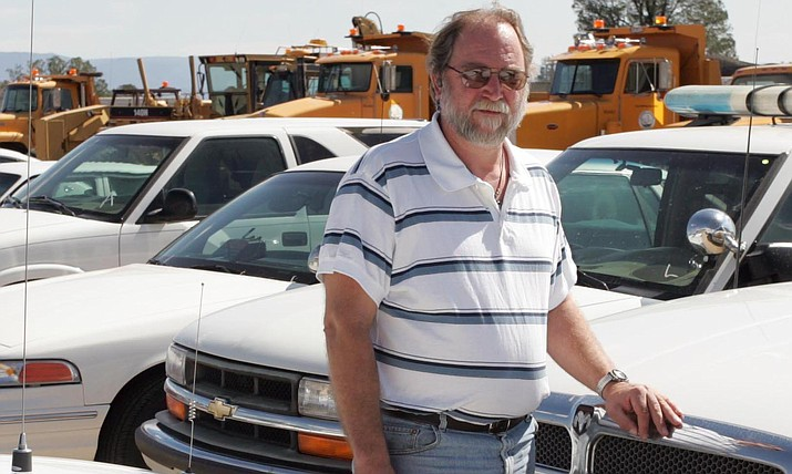 Dave Gartner stands amongst some of the vehicles being readied for disposal at Yavapai County Fleet Maintenance building Sept. 13, 2007. The Yavapai County Board of Supervisors looked at its vehicle damage guidelines at a study session Aug. 1, 2018. (Les Stukenberg/Courier, file)