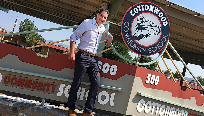 Cottonwood Community School Principal Matt Schumacher stands with the school's marquee as the school formerly known as Cottonwood Middle School now shows its new name. C-OC schools begin class on Wednesday, Aug. 8. VVN/Bill Helm