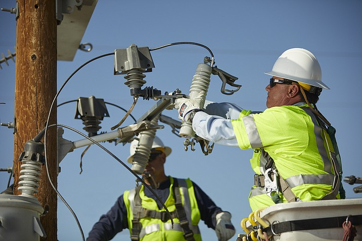 It takes a certain kind of person to be an electrical lineman — they have a tough, physically demanding job. More will be required in the coming years, as half of the linemen in the U.S. reach retirement age. (Arizona Public Service/Courtesy)