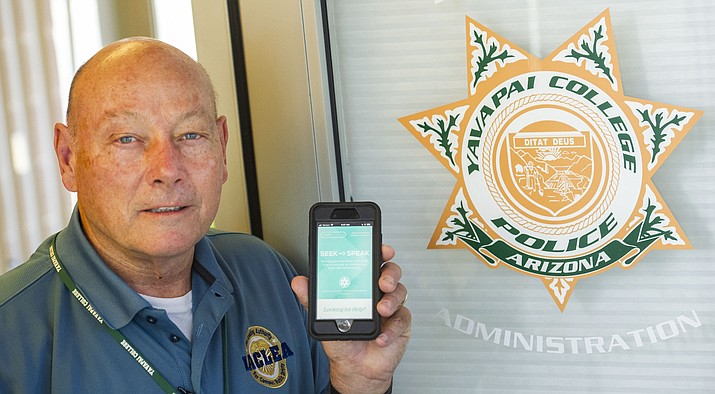 Yavapai College Police Chief Jerald Monahan holds his phone with the new app called Seek then Speak, which is designed to help victims of sexual assault seek assistance and support. (Les Stukenberg/Courier)