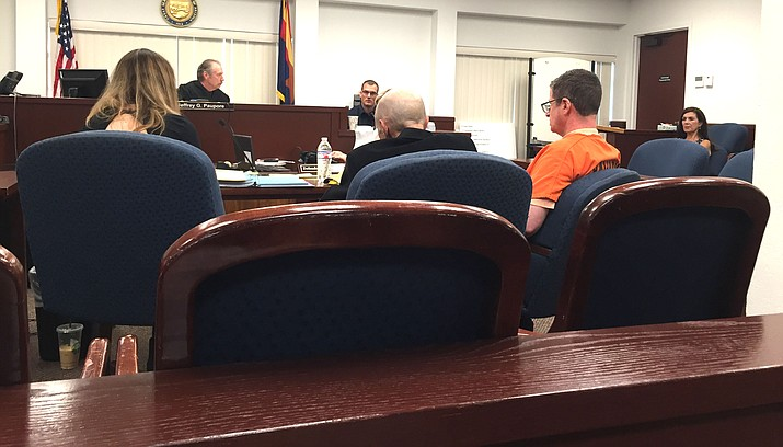 Seth Collins (right) sits with his attorneys before Judge Jeffrey Paupore during an evidentiary hearing held at the Yavapai County Courthouse in Prescott Friday morning, August 3. Photo by Max Efrain