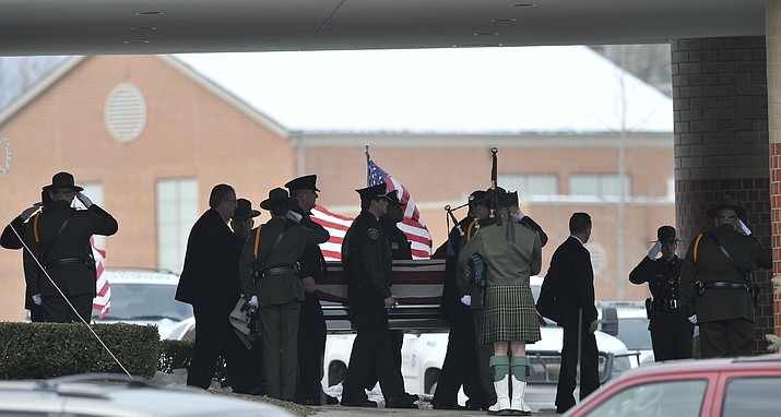 In this 2010, file photo, law enforcement officers carry the casket of Border Patrol officer and former U.S. Marine Brian Terry out of Greater Grace Temple after his funeral service in Detroit. (John T. Greilick/Detroit News via AP, file)