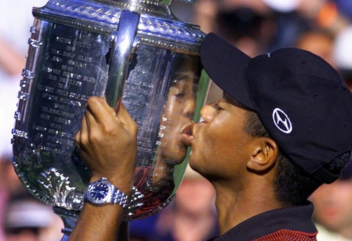 In this Aug. 15, 1999, file photo, Tiger Woods kisses the Wanamaker trophy after winning the 81st PGA Championship at the Medinah Country Club in Medinah, Ill. Woods tied for sixth at the British Open, and now goes to the PGA Championship with a chance to win his first major in 10 years. (Michael S. Green/AP, file)