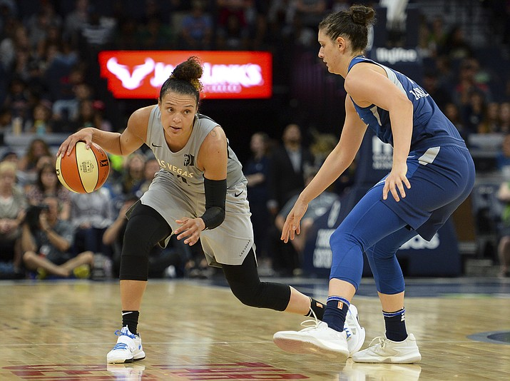 In this July 13, 2018, file photo, Las Vegas Aces guard Kayla McBride drives against Minnesota Lynx forward Cecilia Zandalasini (9) during the second half of a WNBA basketball game in Minneapolis. The Aces had an adventure getting to Washington for their game against the Mystics on Friday night. (Aaron Lavinsky/Star Tribune via AP, File)