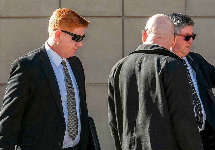 In this March 21, 2018, file photo, Border Patrol agent Lonnie Swartz, left, makes his way to the U.S. District Court building in downtown Tucson. Swartz has never denied shooting 16-year-old Jose Antonio Elena Rodriguez in 2012, but said the teen was throwing rocks at him across the border. His attorneys have argued Swartz was acting in self-defense. (Ron Medvescek/Arizona Daily Star via AP, File)