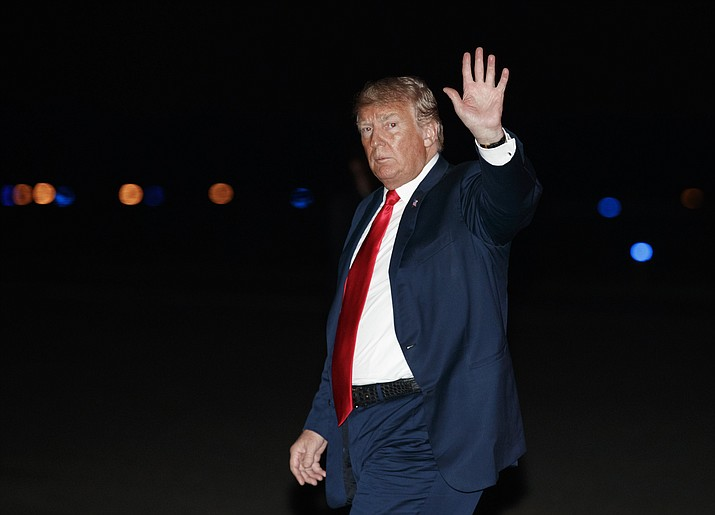 President Donald Trump waves as he arrives on Air Force One at Morristown Municipal Airport, in Morristown, N.J., Saturday, Aug. 4, 2018, en route to Trump National Golf Club in Bedminster, N.J., after attending a rally in Lewis Center, Ohio. (Carolyn Kaster/AP Photo)