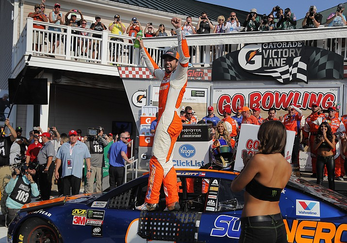 Chase Elliott, center, celebrates after winning a NASCAR Cup Series auto race, Sunday, Aug. 5, 2018, in Watkins Glen, New York. (Julie Jacobson/AP Photo)