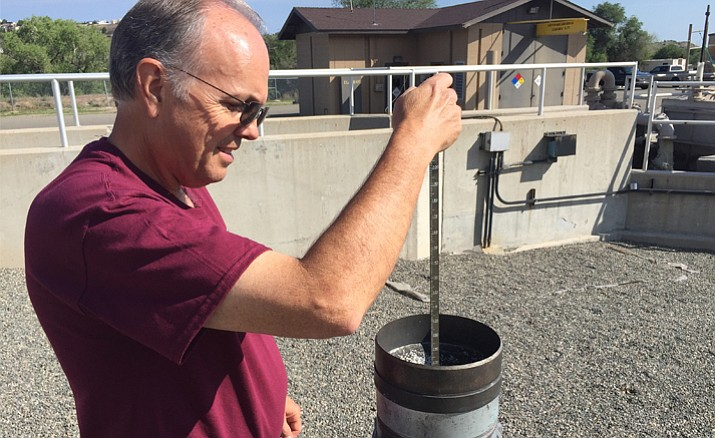 Jim Rhodes measures the precipitation amount received at the Sundog Wastewater Treatment Plant in Prescott on Monday, July 30, from a traditional rain gauge. The treatment plant is considered a volunteer cooperative weather observation station by the National Weather Service. Its official weather station is located at the Prescott Municipal Airport. (Max Efrein/Courier)