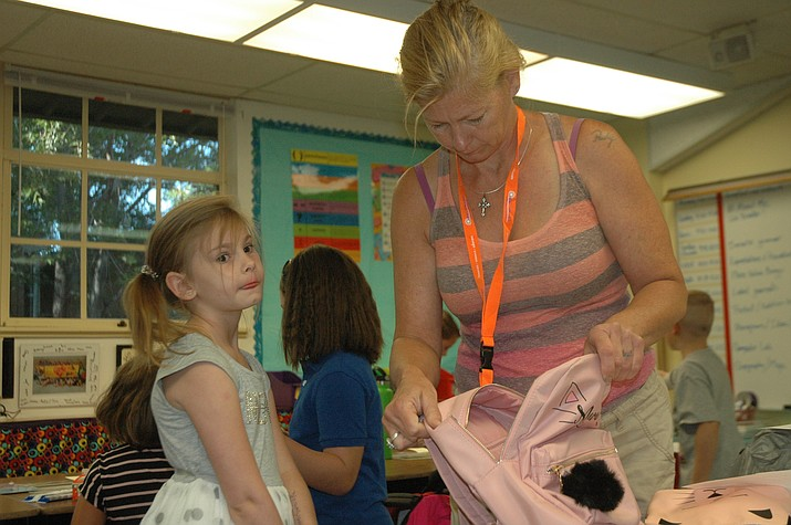 Pam McNamara gets her daughter Bella McNamara settled for the first day of third grade in Robin Bond's class at Del Rio Elementary School Monday, Aug. 6. (Jason Wheeler/Courier)