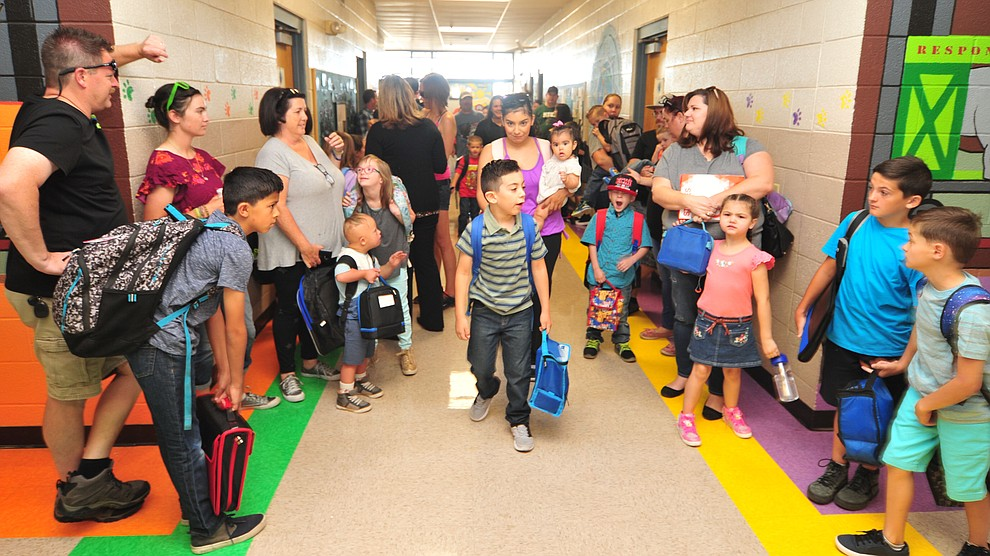 Parents and students wait for in the hallway on the first day of school at Coyote Springs Elementary in Prescott Valley Monday, August 6, 2018.  (Les Stukenberg/Courier)