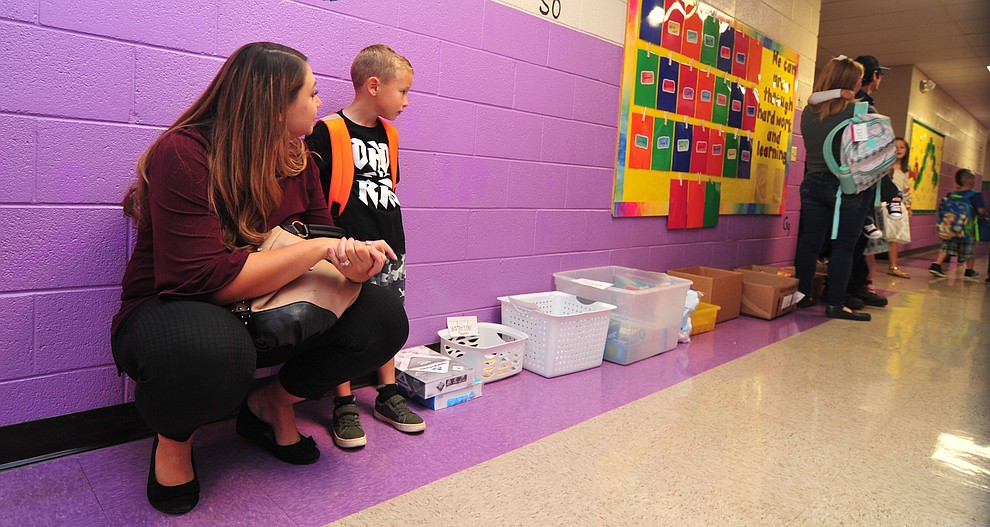 Brandy Reed waits with her kindergartner Liam Reed on the first day of school at Coyote Springs Elementary in Prescott Valley Monday, August 6, 2018.  (Les Stukenberg/Courier)