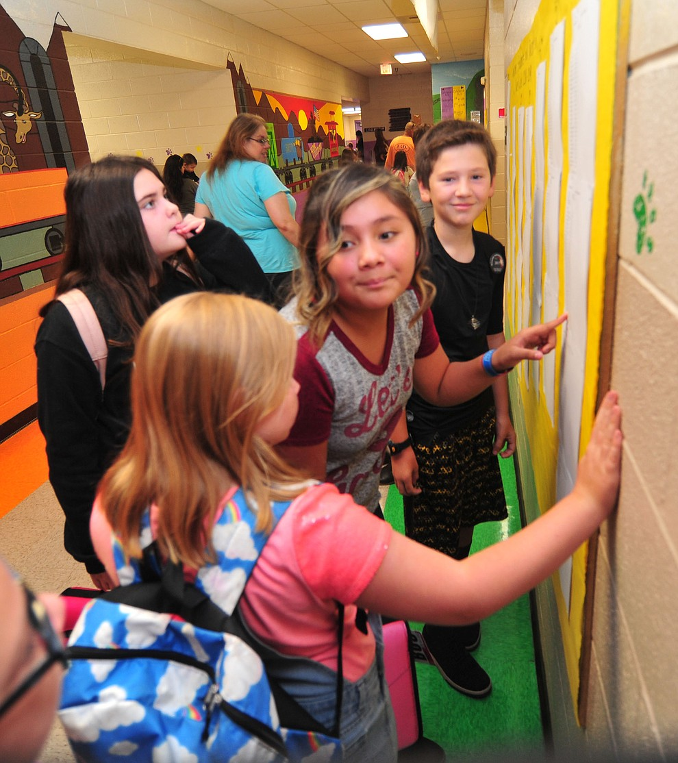 Sixth graders check the class lists during the first day of school at Coyote Springs Elementary in Prescott Valley Monday, August 6, 2018.  (Les Stukenberg/Courier)