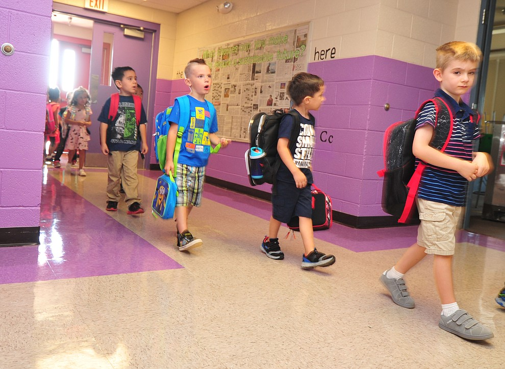 Kindergartners head to class during the first day of school at Coyote Springs Elementary in Prescott Valley Monday, August 6, 2018.  (Les Stukenberg/Courier)