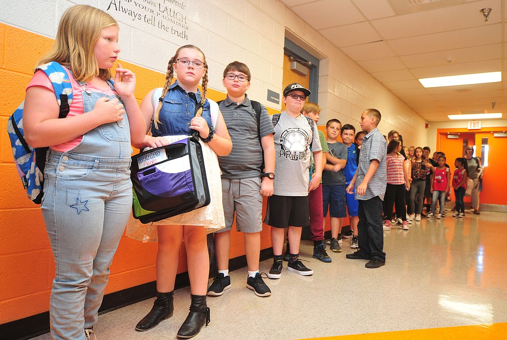 Students wait in the hallway during the first day of school at Coyote Springs Elementary in Prescott Valley Monday, August 6, 2018.  (Les Stukenberg/Courier)