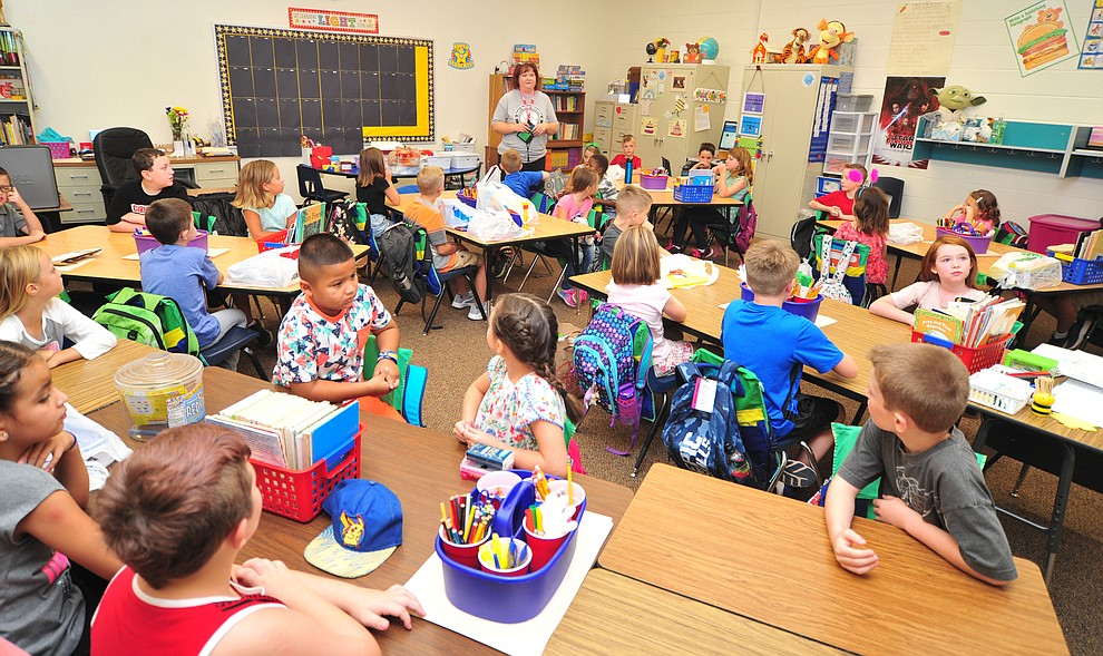 Third graders start the school year on the first day of school at Coyote Springs Elementary in Prescott Valley Monday, August 6, 2018.  (Les Stukenberg/Courier)