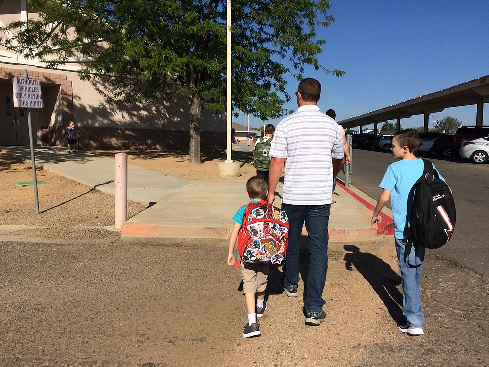 Walking up to school on the first day of school Monday, Aug. 6, at Mountain View Elementary School in Prescott Valley. (Sue Tone/Courier)