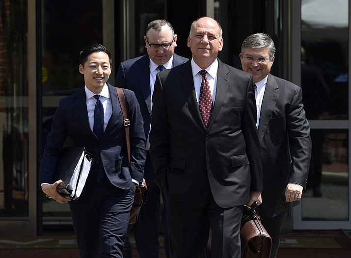 Thomas Zehnle, second from right, attorney for Paul Manafort, walks with other members of the defense team to Alexandria Federal Courthouse in Alexandria, Virginia, Monday, Aug. 6, 2018. Manafort, President Donald Trump's former campaign chairman, is on trial for tax evasion and bank fraud. (Susan Walsh/AP Photo)