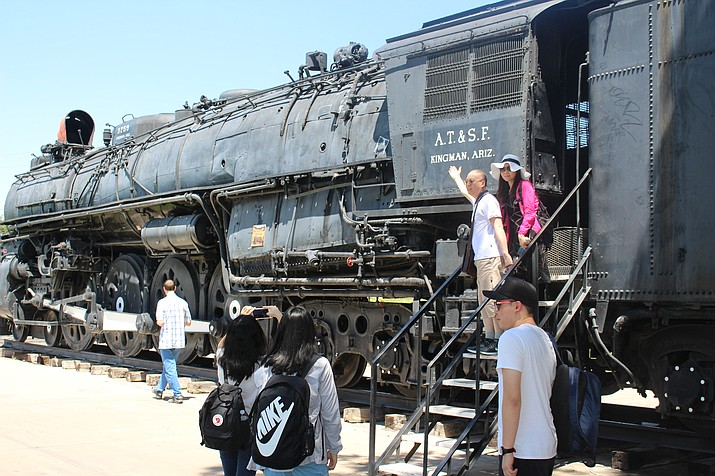 Tourists visiting Kingman making sure their memories are documented. (Photo by Hubble Ray Smith/Daily Miner)