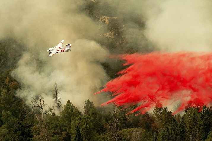 An air tanker drops retardant while fighting to stop the Ferguson Fire from reaching homes in the Darrah community of unincorporated Mariposa Count, California. (AP Photo/Noah Berger)