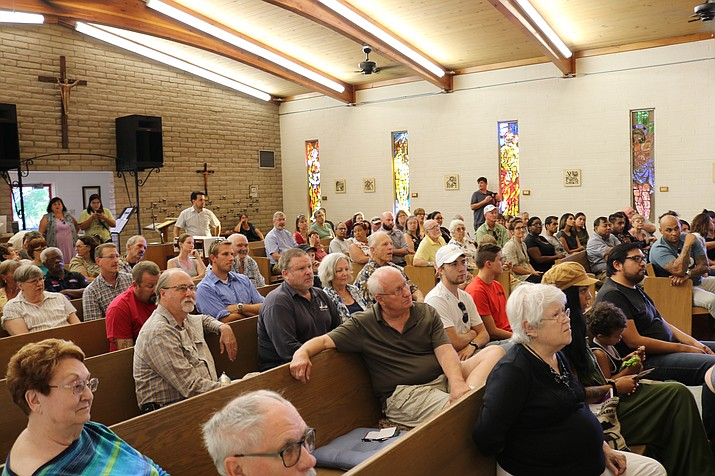 The pews at Trinity Episcopal Church were packed Monday for a Discussion of Intolerance and Racism in Our Community, hosted by the Kingman Progressive Alliance for Positive Change. (Travis Rains/Daily Miner)