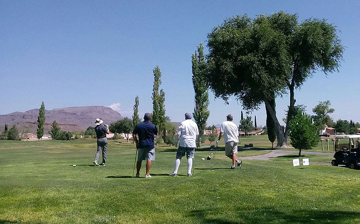 Golfers tee off Saturday at Cerbat Cliffs Course during the 22nd annual Kingman Powerhouse Kiwanis Clothe the Kids fundraiser. (Photo courtesy of Hyperspace Internet Technologies)