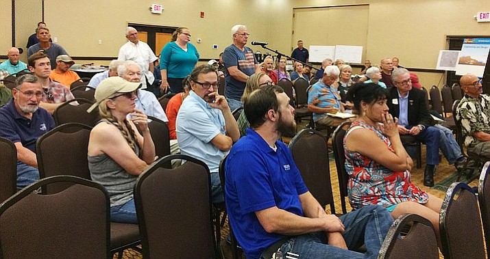 People with questions and comments on the proposed ITC Big Chino Valley Pumped Storage Project line up June 27, at the Prescott Resort. About 60 people attended the community meeting, most from Chino Valley and Paulden. (Sue Tone/Prescott Daily Courier)