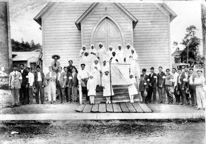 A group of people in front of the Catholic Church in Williams.(Courtesy of Williams Historic Photo Archives)