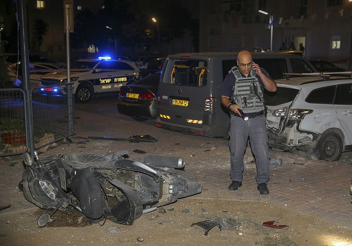 Israeli security stands at the site where a missile from Gaza Strip hit in the town of Sderot, Wednesday, Aug. 7, 2018. Sirens wailed in southern Israel warning of incoming projectiles from Gaza and Israeli media reported two people were lightly injured from shrapnel in the border town of Sderot. (Yehuda Peretz/AP)