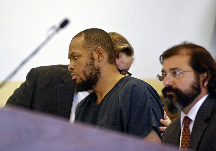 Siraj Ibn Wahhaj, center, confers with one of his attorneys at a first appearance in New Mexico district court in Taos, N.M., on Wednesday, Aug. 8, 2018, on accusations of child abuse and abducting his son from the boy's mother. (Morgan Lee/AP)