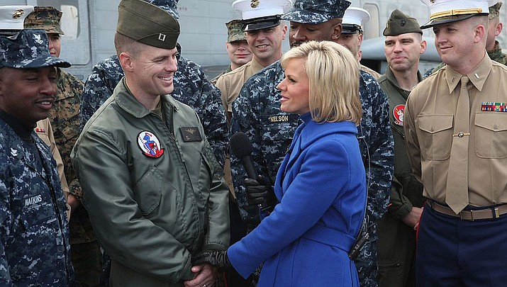 Gretchen Carlson with Captain Russell Hill during her Fox and Friends days. Carlson wants a healing process after the Miss America Organization eliminated the swimsuit competition. (USMC photo)