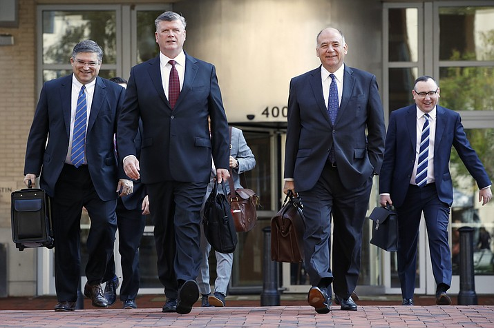 The defense team for Paul Manafort, including Kevin Downing, front left, and Thomas Zehnle, front right, arrive at federal court for the continuation of the trial of the former Trump campaign chairman, in Alexandria, Virginia, Wednesday, Aug. 8, 2018. (Jacquelyn Martin/AP Photo)