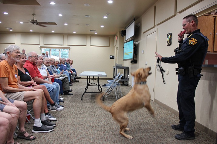 Prescott Police Department K-9 officer Shawn Bray shows off his K-9, Blue, to a crowd of Yavapai Hills community residents on National Night Out on Tuesday, July 7. (Max Efrein/Courier)