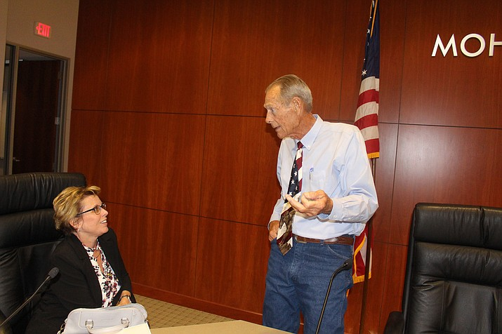 Mohave County Board of Supervisors Chairman Gary Watson talks with Supervisor Hildy Angius after Monday's regular meeting in which the board adopted a final budget of $276.1 million for Fiscal Year 2018-2019. (Hubble Ray Smith/Daily Miner)