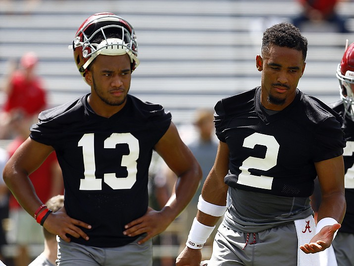 Alabama quarterback Jalen Hurts (2) and quarterback Tua Tagovailoa (13) runs drills during a NCAA college football practice, Saturday, Aug. 4, 2018, in Tuscaloosa, Ala. (Butch Dill/AP)