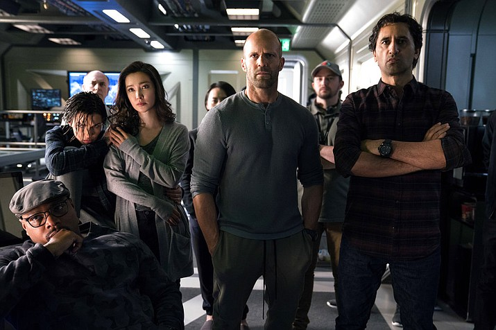 "This image released by Warner Bros. Entertainment shows, foreground from left, Page Kennedy, Ruby Rose, Li Bingbing, Jason Statham and Cliff Curtis in a scene from the film, ""The Meg."" (Warner Bros. Entertainment)"