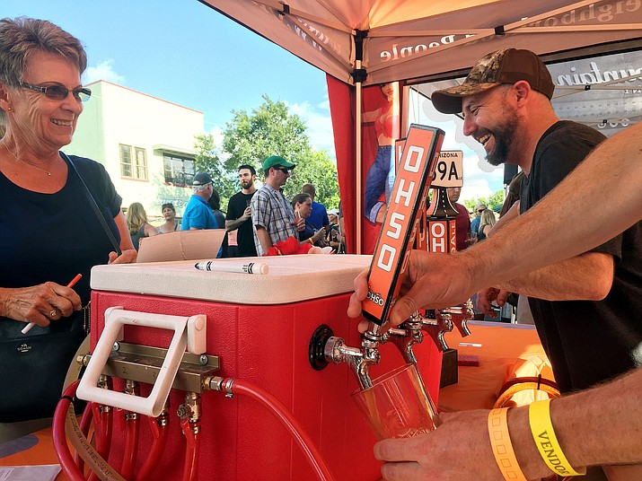 OHSO Brewery crew having fun at their tent with patrons at last year's Brewfest. (Courtesy)