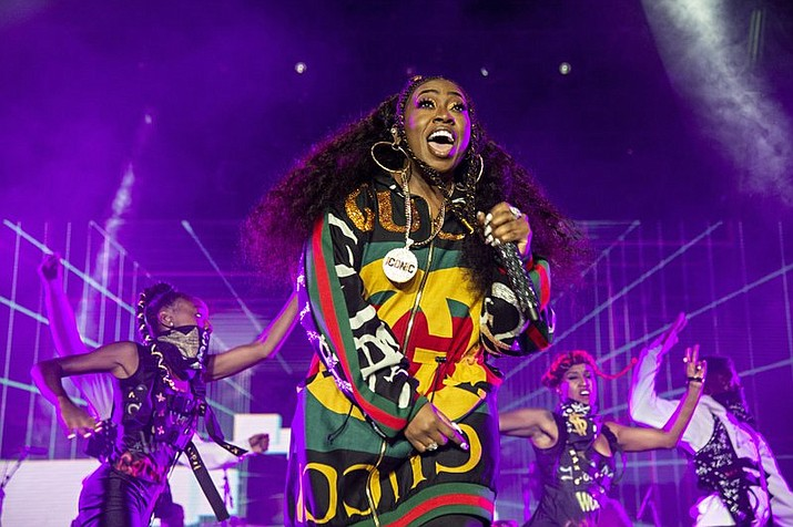 "In this July 7, 2018 file photo, Missy Elliott performs at the 2018 Essence Festival in New Orleans. A Rhode Island woman's karaoke version of Missy Elliott's hit song ""Work It"" has become an internet sensation, even drawing praise from Elliott herself. Mary Halsey, of West Warwick, recently performed a version of the 2002 hit at an outdoor party at a park and posted the performance on her Facebook page. Elliott reposted Halsey's video on Twitter and Instagram and wrote: ""I just found out I have a FUNKY WHITE SISTER."" (Photo by Amy Harris/Invision/AP, File)"