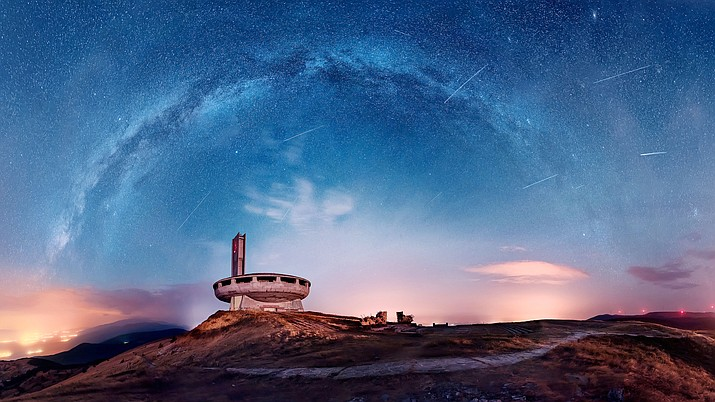 The Perseid meteor shower over Buzludzha, an abandoned monument in Bulgaria. (Stock image)