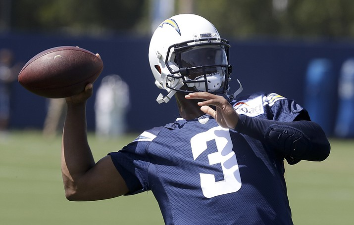 In this June 12, 2018, file photo, Los Angeles Chargers' Geno Smith throws a pass during the team's minicamp in Costa Mesa, Calif. The Chargers must choose between potential and experience when they select the next primary backup to Philip Rivers. (Chris Carlson/AP, file)
