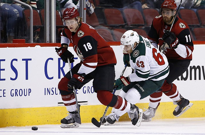 Arizona Coyotes center Christian Dvorak (18) skates with the puck during the second period March 17, 2018, in Glendale. Dvorak signed a six-year extension worth $4.45 million Thursday, Aug. 9, 2018. (Ross D. Franklin/AP, file)