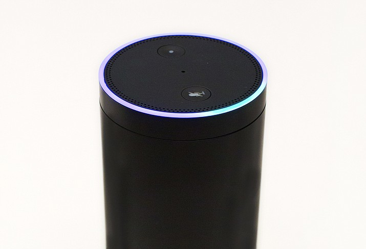 In this June 14, 2018, file photo, an Amazon Echo is displayed in New York. Digital assistants like the Echo don't always understand questions or serve up useful answers, which some parents say is a good thing. But these in-house virtual visitors do create challenges and opportunities for parents, especially those raising younger kids. (Mark Lennihan/AP, file)