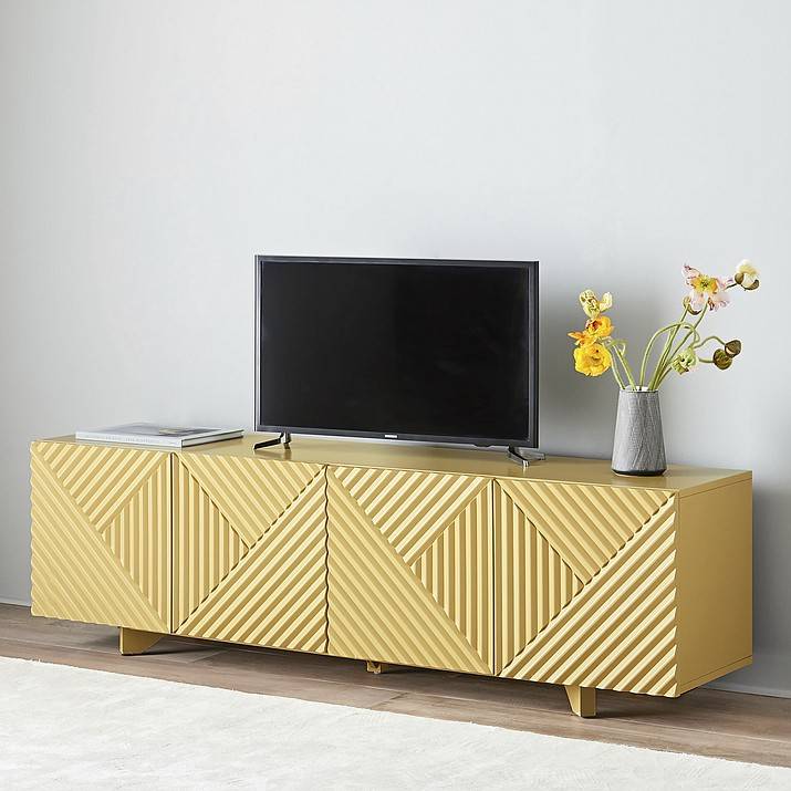 This undated photo provided by West Elm shows Designer Rosanna Ceravalo's carved console for West Elm. In a sophisticated yet playful yellow hue, the piece showcases the intriguing lines and profiles of Deco style – one of this fall's hottest trends. (West Elm via AP)