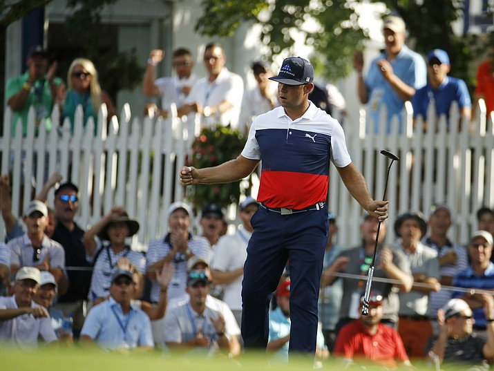 Gary Woodland reacts to a birdie on the 16th hole during the first round of the PGA Championship golf tournament at Bellerive Country Club, Thursday, Aug. 9, 2018, in St. Louis. (Charlie Riedel/AP)