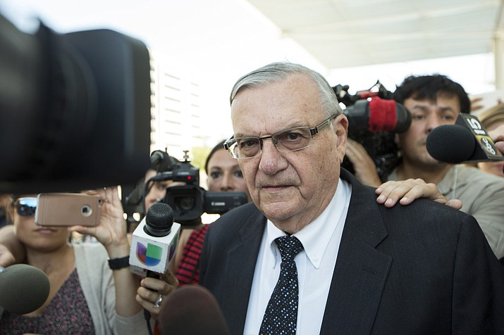 FILE - In this July 6, 2017, file photo, former Sheriff Joe Arpaio leaves the federal courthouse in Phoenix. A judge has dismissed a lawsuit by Sen. Jeff Flake's adult son over now-dismissed animal cruelty charges he faced in the 2014 heat-exhaustion deaths of 21 dogs at a kennel operated by his then-in-laws. Austin Flake and his ex-wife lost the lawsuit against Arpaio and Maricopa County at a trial in late 2017. Since then, they have sought another trial, this time against the case's investigator. (AP Photo/Angie Wang, File)
