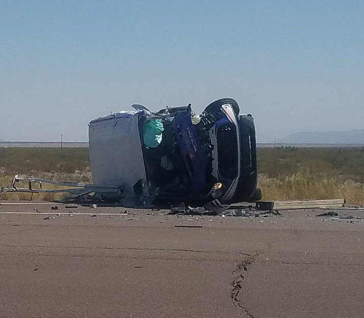Three people were taken to the hospital for treatment of injuries from this crash that occurred Tuesday afternoon on Highway 68 at mile marker 22. A passenger van rolled over after being struck by a Chevrolet Avalanche. (Submitted photo by Robert Hoel)