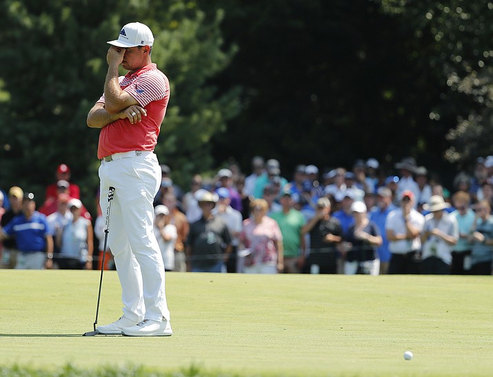 Gary Woodland reacts after missing a putt on the fifth green during the second round of the PGA Championship golf tournament at Bellerive Country Club, Friday, Aug. 10, 2018, in St. Louis. (Jeff Roberson/AP)