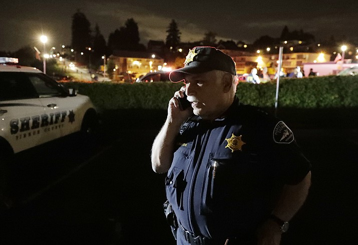 Pierce County Sheriff Paul Pastor talks on his phone at a staging area, Friday, Aug. 10, 2018, at the ferry terminal in Steilacoom, Wash., near where a Coast Guard spokeswoman said the agency was responding to a report of a smoke plume and possible plane crash. Earlier in the evening, officials at Seattle-Tacoma International Airport said an Alaska Airlines plane had been stolen and later crashed. (Ted S. Warren/AP)