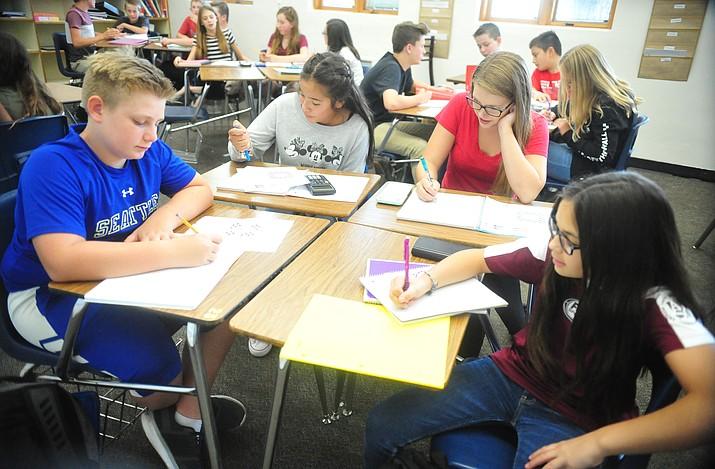 Ryan Orvis, Teresa Marin, Sophia Hohrein and Braelyn Collett work on a problem in Amanda Fagin's Algebra 1 class at Prescott Mile High Middle School Friday, Aug. 10, 2018.  (Les Stukenberg/Courier)