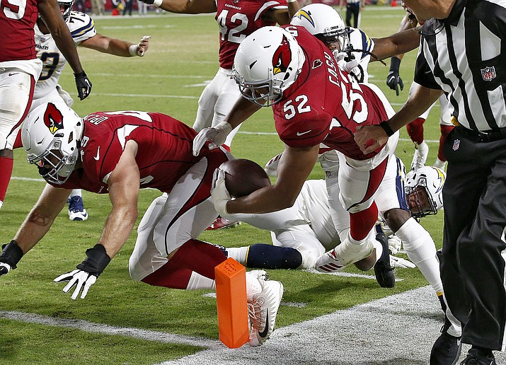 Arizona Cardinals linebacker Jeremy Cash (52) runs back a fumble recovery for a touchdown against the Los Angeles Chargers during the second half of a preseason NFL football game, Saturday, Aug. 11, 2018, in Glendale, Ariz. (Ross D. Franklin/AP Photo)